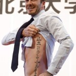 David Beckham showing his Chinese students his tattoo.